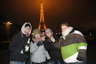 People celebrate New Year's Even with champagne near the Eiffel Tower in Paris last year. ne of the world's oldest shared traditions, New Year's celebrations take many forms, but most cultures have one thing in common -- letting one's hair down after a long, hard year.