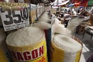 A worker prepares sack of rice for sale at a market in Manila January 21, 2013. The Philippines has forecast an 11 percent increase in output of rice in 2013 as it aims to become self-sufficient in the grain this year, the country's agriculture secretary said on Monday, a decision that may keep global rice prices down. (REUTERS/Romeo Ranoco)