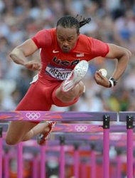 US' Aries Merritt competes in the men's 110m hurdles semi-finals at the athletics event of the London 2012 Olympic Games on August 8, 2012 in London. AFP PHOTO / OLIVIER MORIN