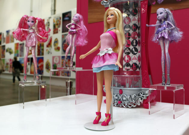 "In this Oct. 11, 2010 photo, a display of dolls, clothes, sets and accessories tied to a ""Barbie, A Fashion Fairytale"" promotion, are seen in a break area at the Design Center at the corpora"
