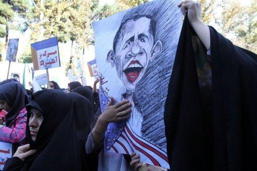 A Iranian woman holds a cartoon image of Barack Obama during an anti-US rally outside the former US embassy in Tehran on November 2. Iran has given a lukewarm reaction to the re-election of Obama, warning that the result would not lead to a normalisation of ties but not ruling out hope altogether