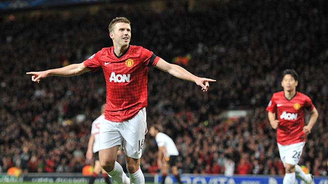 Manchester United's Michael Carrick celebrates scoring their first goal against Galatasaray