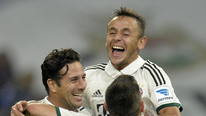 Bayern's scorer Claudio Pizarro of Peru, left, is celebrated by Rafinha and Franck Ribery during the German soccer Bundesliga match between FC Schalke 04 and Bayern Munich at the arena in Gelsenkirchen, Germany, Saturday, Sept. 21, 2013. Schalke was defeated by Bayern with 0-4