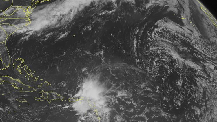 This NOAA satellite image taken Wednesday, June 19, 2013 at 10:45 AM EDT shows tropical wave over the Lesser Antilles with light to moderate rain and thunderstorms. Fair weather across the remainder of the Caribbean with a chance of isolated afternoon thundershowers. (AP PHOTO/WEATHER UNDERGROUND)