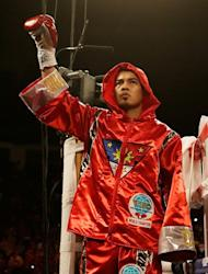 Nonito Donaire of the Philippines waves to the crowd before his WBO super bantamweight title bout vs Jorge Arce of Mexico at the Toyota Center in Houston, Texas, on December 15, 2012. Donaire knocked out Arce at the end of the third round, for his 30th win in a row
