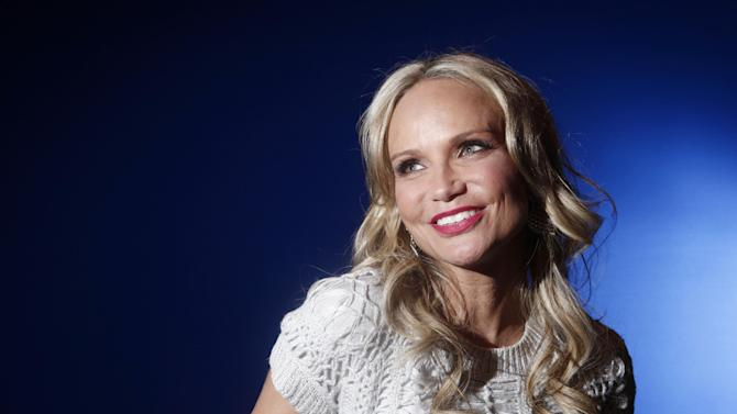 """In this Feb. 28, 2012 photo, actress Kristin Chenoweth poses for a portrait while promoting her ABC show """"GCB,"""" in New York. Chenoweth says she's still on the mend after suffering injuries last July while filming the CBS drama """"The Good Wife.""""  Appearing on """"Live! with Kelly & Michael"""" on Friday, Sept. 7, the pixyish actress offered details of the accident, which happened during a New York location shoot. (AP Photo/Carlo Allegri, file)"""