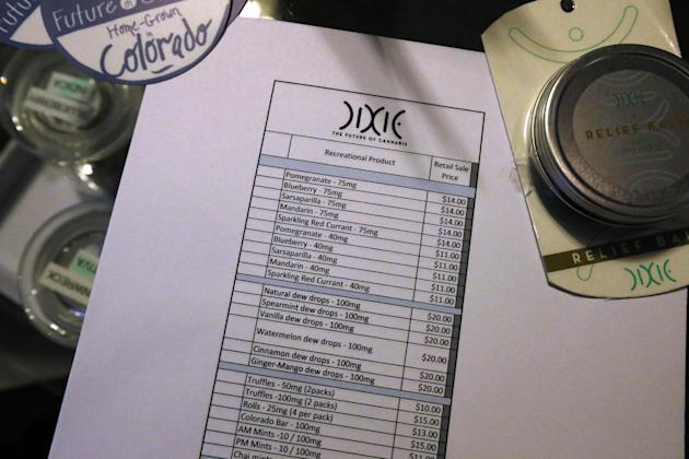 A recreational marijuana menu and price list sits on a counter at 3D Cannabis Center, which opened as a legal recreational retail outlet in Denver, early Wednesday, Jan. 1, 2014. Colorado began retail