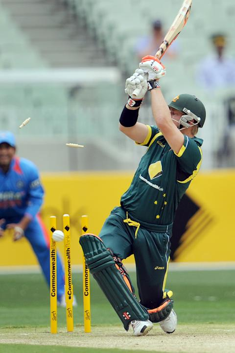 Australian batsman David Warner is bowled by Indian paceman Vinay Kumar in their international one-day cricket match at the Melbourne Cricket Ground (MCG) on February 5, 2012.  IMAGE STRICTLY RESTRICT
