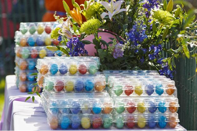 Colorful eggs await the throngs of children attending the annual White House Easter Egg Roll, Monday, April 21, 2014, on the South Lawn of the White House in Washington. Thousands of children are gath