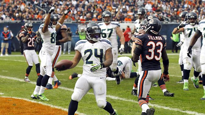 Seattle Seahawks running back Marshawn Lynch (24) celebrates after rushing for a touchdown against the Chicago Bears in the first half of an NFL football game in Chicago, Sunday, Dec. 2, 2012. Bears' Charles Tillman (33) walks away. (AP Photo/Charles Rex Arbogast)