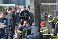 Police and rescuers work inspect the scene after a deadly blast near a school in Brindisi. Reports said investigators were looking into a possible mafia connection but also the hypothesis that it could be linked to a jealous row