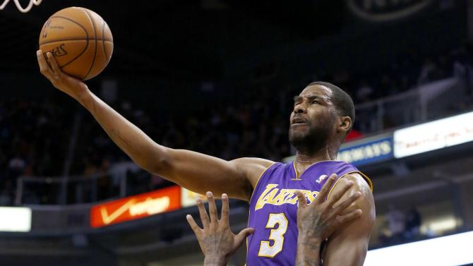 Los Angeles Lakers' Shawne Williams (3) knocks over Phoenix Suns' P.J. Tucker (17) during the first half of an NBA basketball game Monday, Dec. 23, 2013, in Phoenix. Williams was called for charging