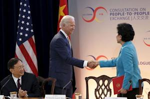 US Vice President Joe Biden shakes hands with Chinese Vice Premier Liu in Washington