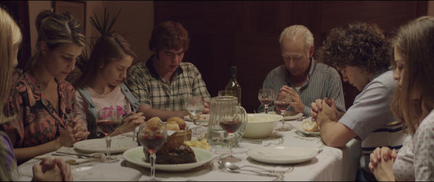 In this undated film frame released by K&S Films, actors playing the members of Puccio pray before dinner during the film The Clan by Argentine filmmaker Pablo Trapero. Over the course of about three