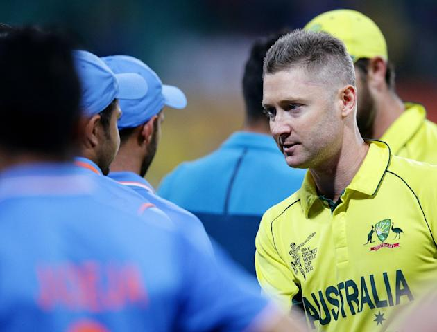 Australia's Michael Clarke shakes hands with the Indian players after their 95 run win in their Cricket World Cup semifinal in Sydney, Australia, Thursday, March 26, 2015. (AP Photo/Rob Griffith)