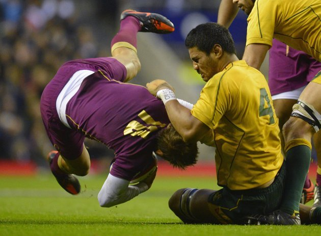 England's Flood is tackled Australia's Timani during their international rugby union match at Twickenham Stadium in London