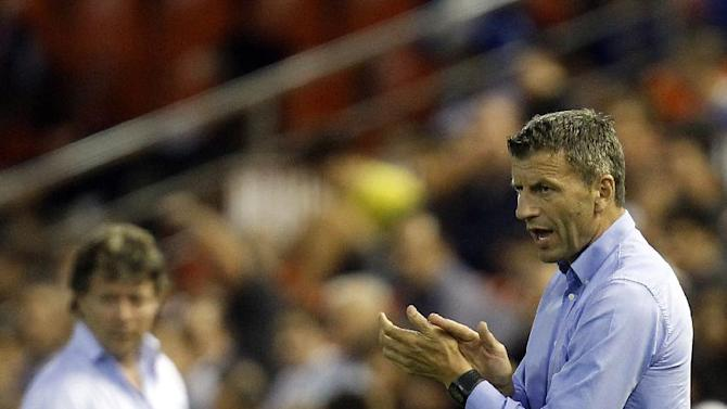 Valencia's coach Miroslav Djukic from Serbia gestures to the players during their Europa  League Group A soccer match against St Gallen at the Mestalla stadium in Valencia, Spain, Thursday , Oct. 24, 2013