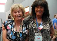 Transgender delegates Jamie Shier (L) and Janice Covington pose for photographs at the Convention Center in Charlotte, North Carolina, on September 4