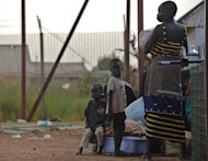 A young South Sudanese mother with her children at the gates of the UNMISS compound in Juba on December 22, 2013