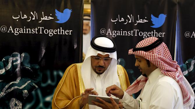 Governor of Qassim region, Prince Faisal bin Mishaal bin Abdul Aziz looks at a tablet during a campaign aimed at raising awareness of terrorism danger in the central Saudi province of Qassim
