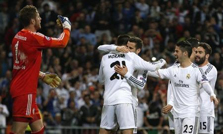 Real Madrid's Alvaro Morata is congratulated by teammates after scoring a goal against Schalke 04 during their Champions League last 16 second leg soccer match at Santiago Bernabeu stadium in Madrid