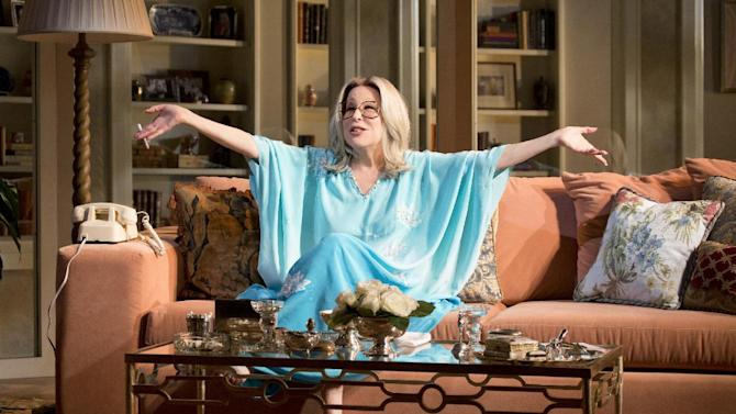 """This theater image released by Boneau/Bryan-Brown shows Better Midler as Hollywood agent Sue Mengers in """"I'll Eat You Last: A Chat with Sue Mengers,"""" at the Booth Theatre in New York. (AP Photo/ Boneau/Bryan-Brown, Richard Termine)"""