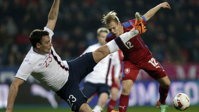 Czech Vydra and Norway's Forren jump for the ball during their international friendly soccer match in Prague