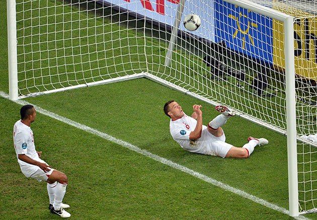 English defender John Terry (R) clears the ball during the Euro 2012 football championships match England vs Ukraine.