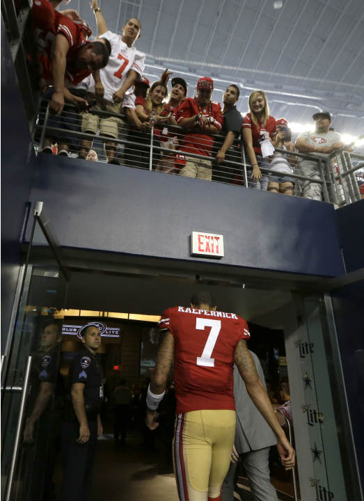 San Francisco 49ers quarterback Colin Kaepernick (7) walks off the field under fans after the NFL football game against the Dallas Cowboys Sunday, Sept. 7, 2014, in Arlington, Texas. (AP Photo/LM Oter
