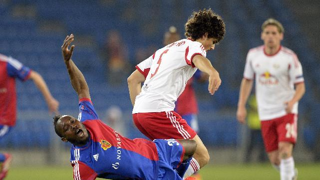 Basel's Giovanni Sio, left, fights for the ball with Salzburg's Andre Ramalho during the Europa League round of sixteen first leg soccer match between Switzerland's FC Basel and Austria's FC Salzburg at the St. Jakob-Park stadium in Basel, Switzerland, on Thursday March 13, 2014