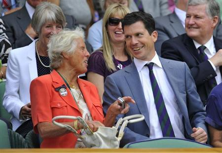 Former British tennis players Anne Jones and Tim Henman talk on Centre Court at the 2010 Wimbledon tennis championships in London