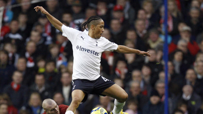 Tottenham Hotspurs' Steven Pienaar, top, vies for the ball with Cheltenham Town's Russell Penn during the English FA Cup third round soccer match at White Hart Lane Stadium in London, Saturday Jan. 7, 2012. (AP Photo/Kirsty Wigglesworth)