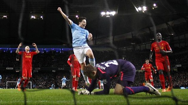 Manchester City's Alvaro Negredo (not pictured) scores a goal against Liverpool as team mate Samir Nasri (C) celebrates during their English Premier League soccer match at the Etihad stadium (Reuters)