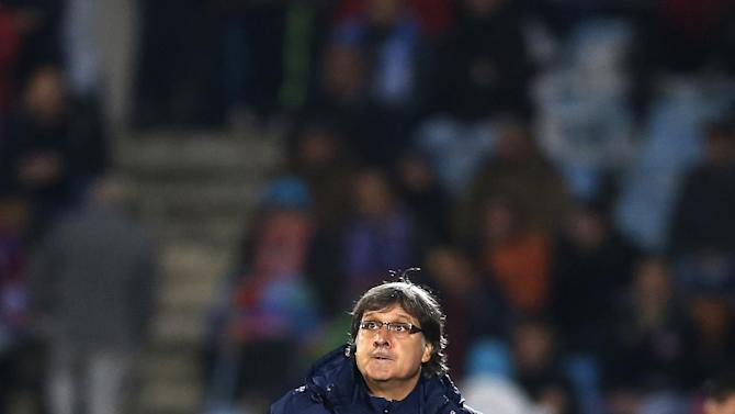 FC Barcelona's coach Gerardo 'Tata' Martino from Argentina looks up during a Spanish La Liga soccer match between FC Barcelona and Getafe at the Coliseum Alfonso Perez stadium in Madrid, Spain, Sunday, Dec. 22, 2013