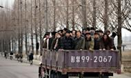 North Koreans commute to work in Pyongyang. North Korea is hardly known for offering a warm welcome to the world's press, and never before has it given access to a sensitive site featuring its latest space hardware