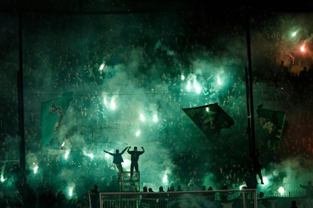 Panathinaikos were fined 190,000 euros and instructed to play four home matches behind closed doors, while the league handed Olympiakos a 3-0 victory for the disrupted match