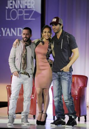Yandel, left, of the group Wisin y Yandel, Jennifer Lopez, center, and Enrique Iglesias pose together after the announcement of their summer tour together, Monday, April 30, 2012, in Los Angeles. The initial 16 dates of the North American tour were announced on Monday, with more dates soon to be announced. (AP Photo/Chris Pizzello)