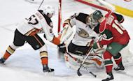 Anaheim Ducks' goalie John Gibson, center, stops the shot of Minnesota Wild's Jason Zucker, right, as the Ducks' Rickard Rakell, left, of Sweden, moves in to defend in the second period of an NHL hockey game, Tuesday, Feb. 14, 2017, in St. Paul, Minn.(AP Photo/Tom Olmscheid)