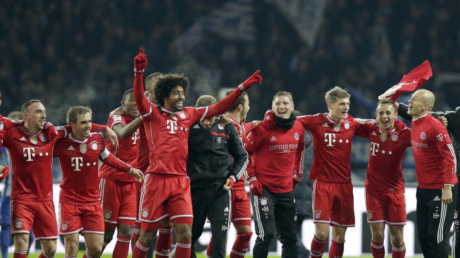 Bayern's Arjen Robben of the Netherlands, right, Bayern's Franck Ribery of France, left, and their teammates celebrate winning the German soccer championship after the German Bundesliga soccer match between Hertha BSC Berlin and Bayern Munich in Berlin, Germany, Tuesday, March 25, 2014. (AP Photo/Michael Sohn)