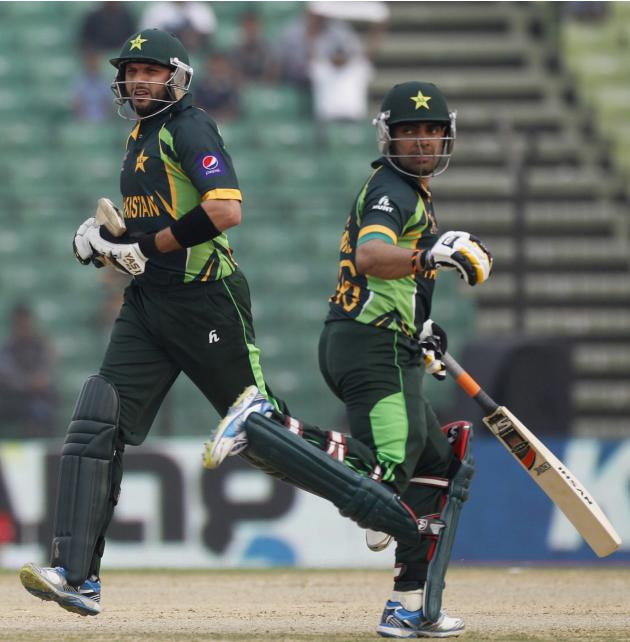 Pakistan's Afridi and Akmal run between the wickets against Afghanistan during their Asia Cup 2014 ODI cricket match in Fatullah