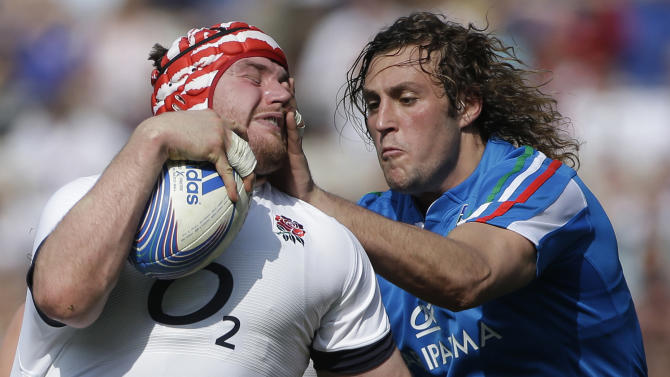 Italy's Joshua Furno, right, tries to tackle England's Ben Morgan during the Six Nations Rugby Union match between Italy and England at Rome's Olympic stadium, Saturday, March 15, 2014. (AP Photo/Gregorio Borgia)
