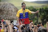 Venezuelan opposition candidate Henrique Capriles waves as he speaks during the opening rally of his campaign in San Francisco de Yuruani, Bolivar state, Venezuela on July 1, 2012