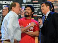 LAS VEGAS, NV - JUNE 08: Boxer Manny Pacquiao (C) and boxing promoter Bob Arum are interviewed during the official weigh-in at the MGM Grand Garden Arena on June 8, 2012 in Las Vegas, Nevada. Pacquiao will defend his WBO welterweight title against Timothy Bradley on June 9 in Las Vegas. (Photo by Kevork Djansezian/Getty Images)