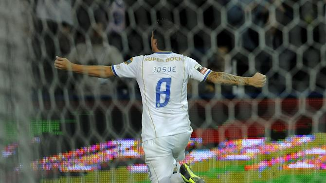 FC Porto's Josue Pesqueira celebrates after scoring a penalty shot against Vitoria Guimaraes in a Portuguese League soccer match at the Dragao Stadium in Porto, Portugal, Friday, Sept. 27, 2013. Josue scored the only goal in Porto's 1-0 victory