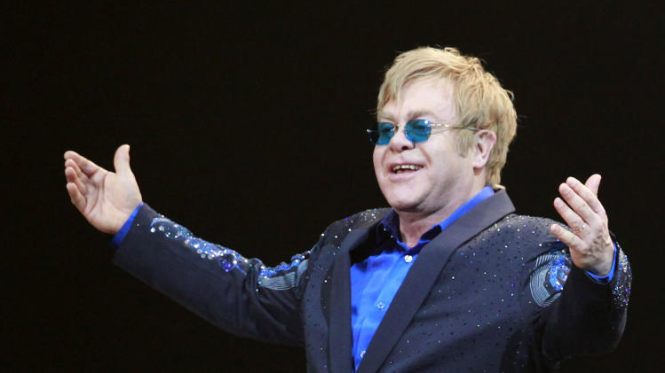 FILE - In this Nov. 23, 2012, file photo shows Elton John during his concert at Mercedes-Benz Arena in Shanghai, China. Elton John is recovering after an operation to remove his appendix. The musician's publicist says John had the surgery last week at Princess Grace Hospital in Monaco, near his home in the south of France. (AP Photo/Eugene Hoshiko, File)