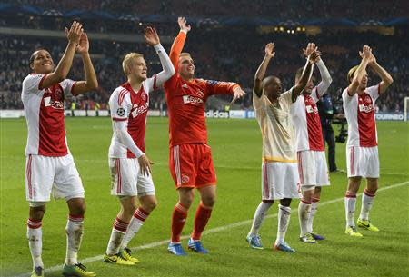 Ajax Amsterdam's players celebrate their victory against Celtic after their Champions League soccer match at Amsterdam Arena