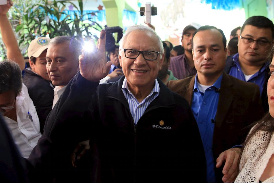Handout photo of Guatemala's new President Maldonado showing his ink-marked finger after casting his vote at a polling station during general elections in Guatemala City