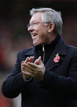Manchester United's manager Sir Alex Ferguson applauds supporters after a presentation commemorating his 25 years in charge of the club before the team's English Premier League soccer match against Sunderland at Old Trafford Stadium, Manchester, England, Saturday Nov. 5, 2011. (AP Photo/Jon Super)