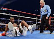 Jeffery Mathebula of South Africa hits the canvas for a mandatory eight count after being put down by Nonito Donaire of the Phillipines during the fourth round of the WBO IBF Super Bantamweight title fight at The Home Depot Center on July 7, in Carson, California. Donaire won with a 12-round unanimous decision