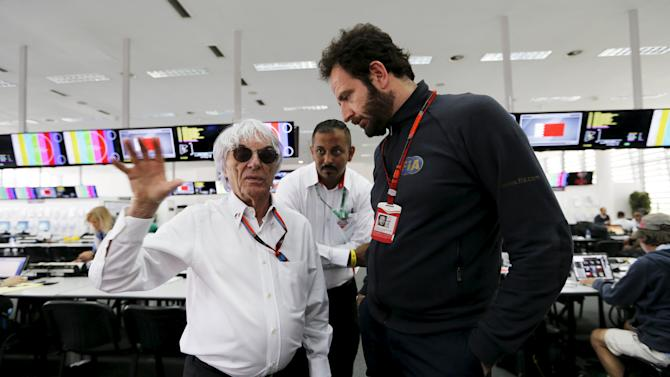 Formula One supremo Bernie Ecclestone visits the media centre at the Bahrain International Circuit during Bahrain's F1 Grand Prix, south of Manama